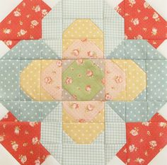 "This block - #5 of Fat Quarter Shop's Designer Mystery Block of the Month Club (2011).  Designed by Brenda Riddle, called ""Vintage Posey"" and is absolutely adorable!"