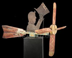 Antique Whirligig, Man Tipping Top Hat, Circa 1900, facing right angle view