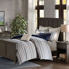 The classic Coastal Farmhouse Comforter Queen Size 8-Piece Set sports a navy and ivory woven jacquard stripe pattern for a fresh update to your beach home space.