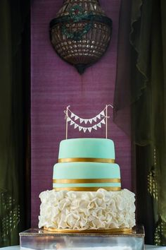 Wedding cake. Mint green and gold.