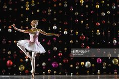 Principal dancer Constance Devernay, dressed in the sugar plum fairy costume poses against a backdrop of Christmas baubles at the Tramway on September 19, 2017 in Glasgow, Scotland. Scottish Ballet needs the public to help them restore and refresh the sparkle of The Nutcracker set and costumes before it returns to the stage this winter. Through The Nutcracker Bauble Appeal, members of the public can 'buy a bauble' from this iconic set and play a part in helping to revive this beloved ballet.