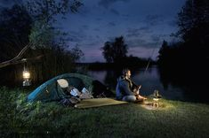 Stock Photo : Germany, Bavaria, Ammersee, Man sitting near lakeshore with lantern and fishing at dusk Avatar, Fishing Tent, Camping Photo, Man Sitting, Camping Equipment, High Resolution Photos, Bavaria, Outdoor Gear, Lanterns