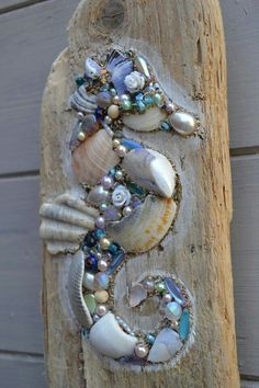 Driftwood Seahorse Wall Hanging using shells and pearls, Handmade in Cornwall. Something like this would look good applied directly to a fence postToo cool on driftwood, seahorse bling!This lovely driftwood wall hanging is made using reclaimed driftw Driftwood Seahorse, Seashell Art, Seashell Crafts, Driftwood Art, Seahorse Art, Driftwood Projects, Driftwood Ideas, Seashell Projects, Sea Crafts