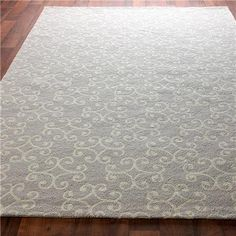 Scrolling Medallion Hooked Rug: 2 Colors  Hand-hooked wool in your choice of the softest Gray with Cream scroll or a warm Dark Chocolate with Light Chocolate scroll, this transitional rug can go from modern to classic decor.  Imported.  (Specify color and size when ordering)    Product SKU: XH1159 0508GY  Price:  $384.00 http://www.shadesoflight.com/scrolling-medallion-hooked-rug-2-colors.html#