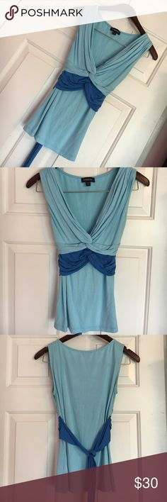 Bebe Shades of Blue Tank/Blouse Beautiful. Stretchy, soft, tie in back, beautiful shades of blue. All my Bebe tops cost between $35 and $90. I price accordingly. Awesome condition. Also have one in pink and brown. Bebe Tops Tank Tops