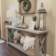 farmhouse console table vignette with a storage shelf