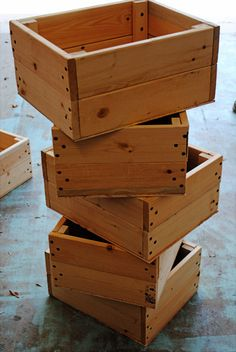 DIY Crate Tutorial {simple, cheap & easy}...this would be a cheaper way to get all the organized storage I love without the big cost of buying real crates OR baskets. LOVE the handles she put on the front...great addition!!