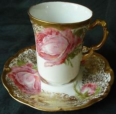 I just happened upon this cup and saucer, and I couldn't resist it. Just look at that pink rose! It reminds me of my David Austin 'Bishop's Castle' rose. Can you imagine a whole set of these, along with the chocolate pot!