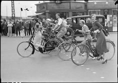 vintage everyday: 21 Rare Vintage Photos Capturing People Cycling on Copenhagen Streets from between the 1930s-40s