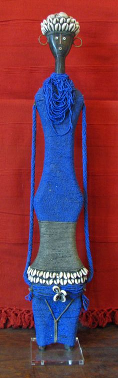 Namji Fertility Doll from Cameroon. Hand made with glass trade beads, cowry & conus shells, cotton yarn & acrylic base.
