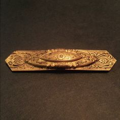 "Vintage Antique Brass Fanciful Bar Pin An exquisitely designed vintage brass pin with scrollwork and floral attributes. Measures approx 3"" x 1/2"". In wonderful preowned vintage condition Vintage Jewelry Brooches"