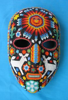 a beaded mask that depicts a woman made by a Huichol artist who lives in Mexico City South American Art, Native American, Mexican Mask, Mexican Party, Yarn Painting, Native Beadwork, Animal Masks, Masks Art, Arte Popular