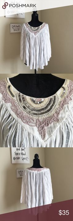 Free People Unique Boho Gypsy Beaded Top Super cute and very unique top from Anthro/Free People. Gives off an extremely bohemian of gypsy vibe. Feels really nice when on because of how flowy the top is. It seems like a cross between a poncho and a cape, but it does have arms. All of the beading, sequins, and embroidery around the neckline is intact. Only issue is the presence of a tiny orange stain on the neckline. Not very visible and I'm certain it will come out of you try, I just don't…