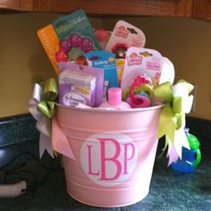 Bucket Full of Goodies  Spray-paint a bucket pink and fill it with goodies for mom-to-be. Have guests write sweet notes on the diapers and mom can read them when she's up in the middle of the night changing!