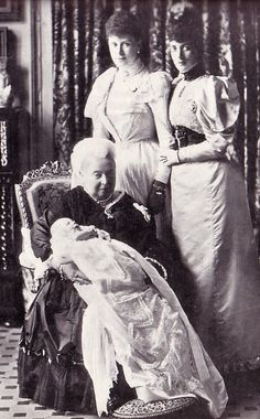Queen Victoria with great-grandson Prince Edward of York (later King Edward VIII), The Duchess of York (later Queen Mary), and The Princess of Wales (later Queen Alexandra), 1894.