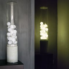 Lamp made from long glass vase, some led-party lights and a concrete base.