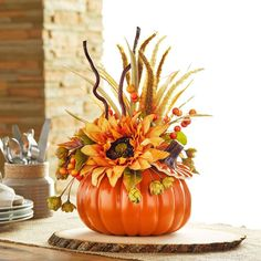 Give your table a colorful fall update with this easy floral arrangement contained in a craft pu...