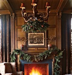 What beautiful garland and what a gorgeous fireplace and chandelier.  I can just hear the crackling fire.