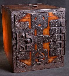 A ship's chest ( 'funa dansu') 'kakesuzuri' type, made entirely of 'keyaki' (zelkova) wood with paulownia interiors. Original iron hardware with two crests on the door panel. Date: Late 18th/early 19th century