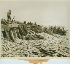 """D+1, American soldiers on """"White Dog"""" beach sector in Normandy, France. 7 June…"""