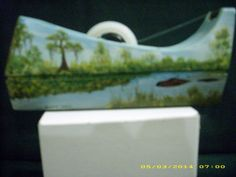 Louisiana Swamp  dispenser that I painted in 1997.  This side has an alligator in the bayou.  The trees are dressed in Spanish Moss.