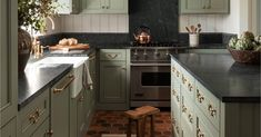 Kitchen with brass fixtures and a terra cotta hex tile floor in a renovated 1930s Tudor Revival home, Tacoma, Pierce County, Washington [1800x2211] : RoomPorn Soapstone Counters, Countertops, Big Kitchen, Kitchen Ideas, Calacatta Gold Marble, Kitchen Facelift, Hex Tile, Rental Kitchen, Kitchen Backsplash