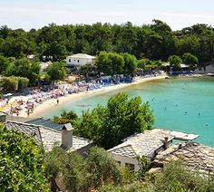 Aliki Beach is at the northeastern side of Thassos in a distance of from Limenas. There are two gulfs in Alyki with beaches of pebbles, sand and crystal waters. Travel With Kids, Travel Destinations, Beach, Places, Water, Outdoor Decor, Road Trip Destinations, Gripe Water, The Beach