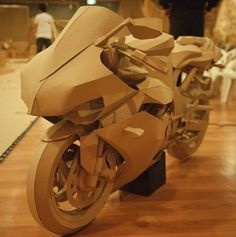 """Floor it! Awesome cardboard bike at the side stage. """"Only if Romeo Knew"""" by Jack Chen."""