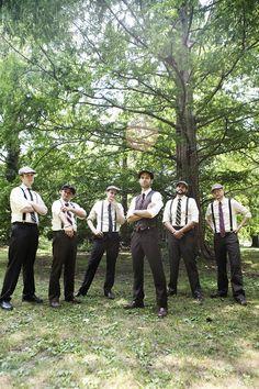 groomsmen in newsboy caps and suspenders