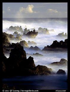 Rocks and waves at sunrise, Keanae Peninsula. Maui, Hawaii, USA (color)