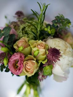 A Passionflower loose, country bridal bouquet, including rosemary, lisianthus, peonies and roses.  www.passion-flower.net