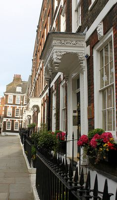 A row of door canopies - Queen Anne's Gate, London.   ASPEN CREEK TRAVEL - karen@aspencreektravel.com