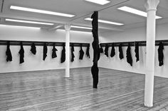 Jannis Kounellis, untitled 2014 iron beams, knives and torn coats variable dimensions
