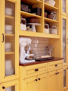 Yellow kitchen will be so much attractive for any home design whether big or small. It gives your room a bright color and more spacious. So, here are some yellow kitchen ideas for designing your kitchen room. Yellow Kitchen Cabinets, Kitchen Cabinets Decor, Farmhouse Kitchen Cabinets, Kitchen Cabinet Design, Kitchen Colors, Kitchen Storage, Kitchen Yellow, Yellow Kitchens, Kitchen Display
