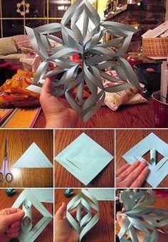 Leuke kerstster om te knutselen (met kinderen).  - Driehoek vouwen en inknippen tot vóór het midden. - Openvouwen en de