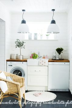 white laundry room with dark tile and butcher block counters