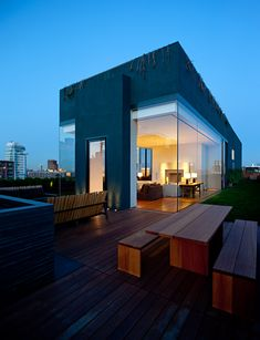 Schrager Apartment in New York by John Pawson. Designed as a freestanding rooftop villa in black stucco.