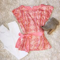 Gorgeous coral sequin front top | Apart Super cute coral sequin top. Ties around waist for a flattering fit! Only worn a couple times. White skinnies for summer, dark wash jeans for fall. Perfect top for a night on the town! Apart Tops Blouses
