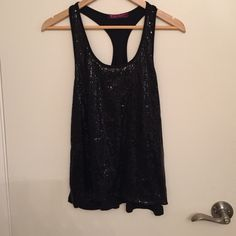 Sequined tank top Black sequined tank with knit back and knit in front against skin. Julie's closet Tops Tank Tops