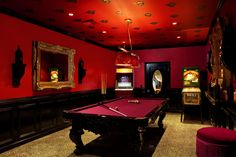 divine-home-billiard-room-design-with-maroon-billiard-table-and-round-ottoman-also-red-colored-wall-and-two-wooden-mirror-featuring-pendant-lamp-and-brown-floor-plus-black-door-and-task-lighting.jpg (1900×1266)