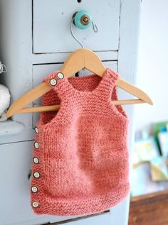 I hate vests with a passion and will never wear one. But this tiny baby vest just made my heart melt:)
