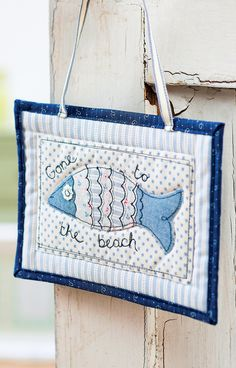 This impressive doorstop and fish sign feature ditsy star, stripe and floral designs in pretty shades