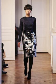 love the pattern of this skirt, though I would pair it with a more flowy blouse