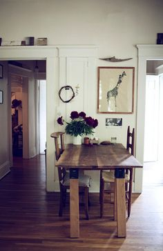 two saw horses + a slab of stained wood (or maybe a discarded door) make a great table