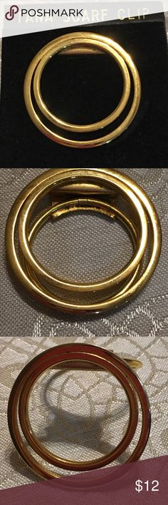 """Tana Germany gold scarf clip Vintage Tana round gold scarf clip still on original jewelry card.  This has been in my jewelry box for a very long time and never used.  Back is stamped """"Germany"""".  Measures 1"""" in diameter at inner circle.  Very good condition. Tana Accessories Scarves & Wraps"""
