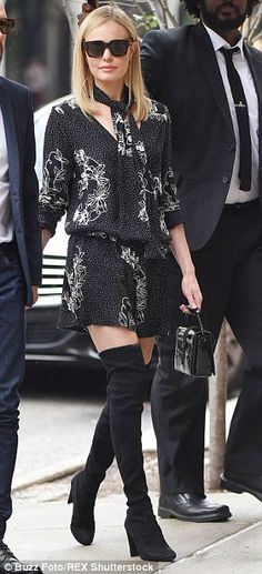 Kate Bosworth slipped into three different outfits in the space of a few short hours in New York on Thursday, seen here in thigh boots and a jumpsuit and in stripes for her first look of the day