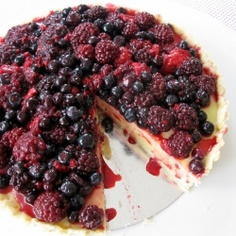 White chocolate tart topped with sweetened mixed berries