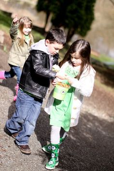 Pin for Later: Finding the Pot o' Gold: A St. Patrick's Day Party Filled With Treats For All Treasure Finders Once the pots were found, the kids examined their loot. Source: Jenny Cookies