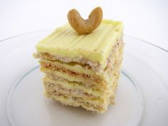 Sans Rival - delicate meringue layers with buttercream frosting and cashews.  Heavenly!