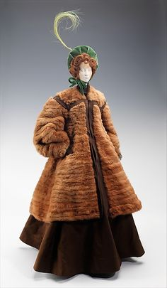 """""""1863 Doll"""", Designer: Weill (French) Designers: Jane Blanchot (French), Jean Clemént (French, 1900–1949) 1949 Medium: metal, plaster, hair, fur, feather, silk Size: 32 x 11 1/2 in. (81.3 x 29.2 cm). The US sent aide to France after WWII in boxcars dubbed the """"American Friendship Train"""" the French created the """"Gratitude"""" or """"Merci Train"""", a set of 49 boxcars filled with gifts of thanks. These dolls made on a wire armature, were included. Each designer chose a style from 1715 to 1906."""